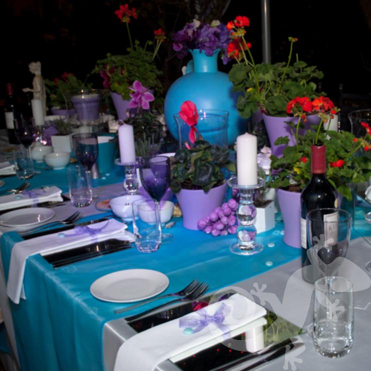 Greek taverna theme, island table setting, potted geraniums