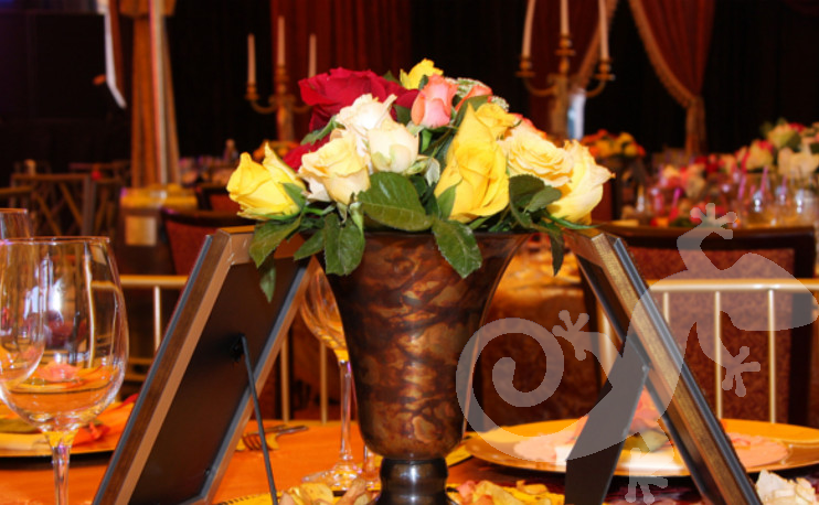 Latin Rhythm, Gala event, silk tablecloth, roses, antique brass container