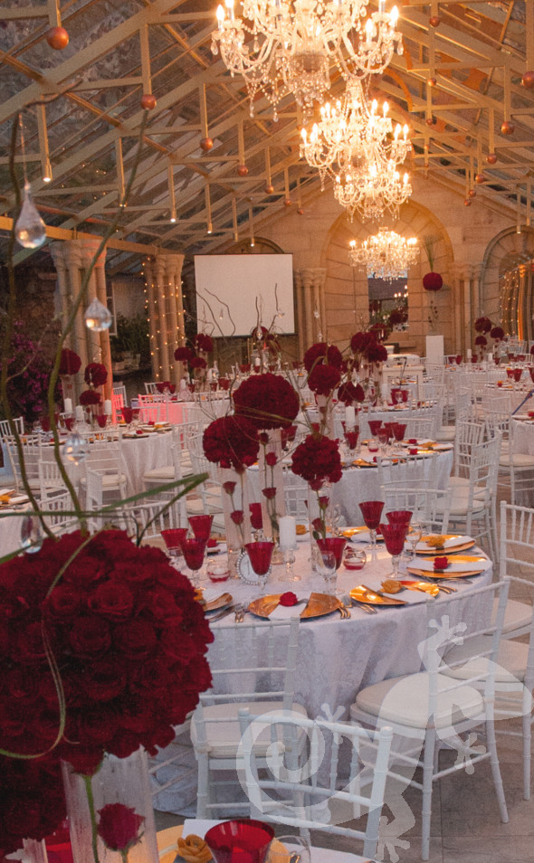 Salamander inspirational tablesettings, red flowers, fiery hot, crystal chandeliers