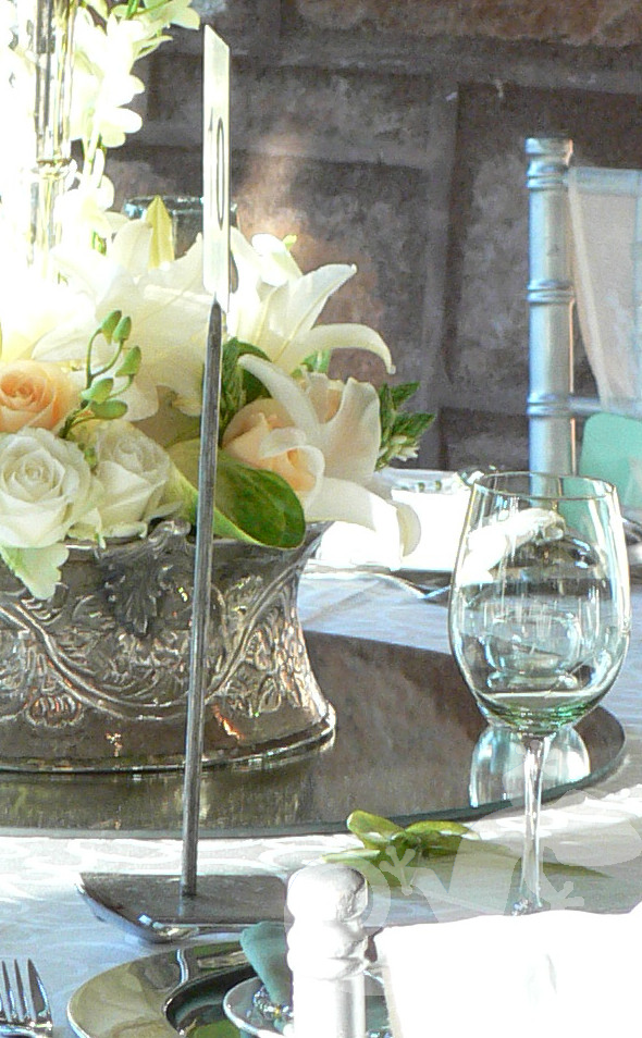 Bridal tablesetting, handbeaten silver container, napkin detail
