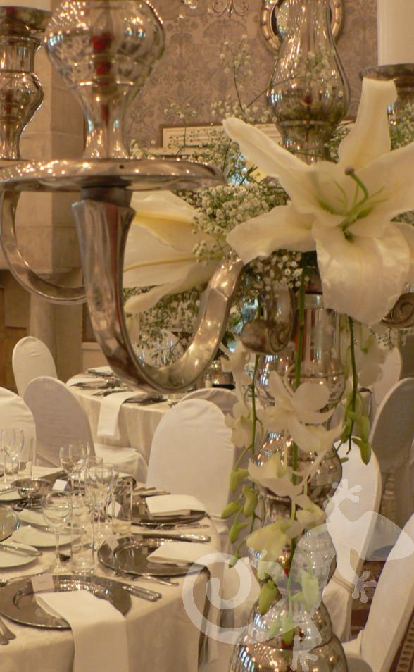 Silver ware, orchids, stargazer lilies